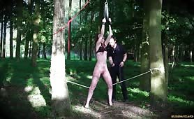 RedHead Dragged In Woods Punished with Wax and Big Masturbation Toy