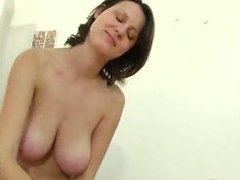 Girlfriend with big boobs gives a handjob