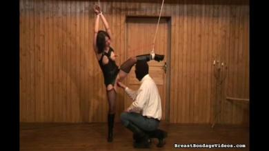 Black suit covering a young bondage teen