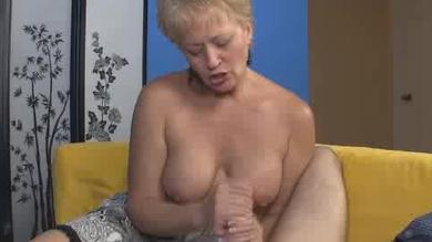 Sexy mature busty milf loves jerking a hard cock