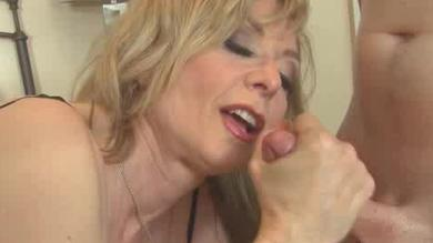 Mature blonde with nice big boobs jerks that meaty cock