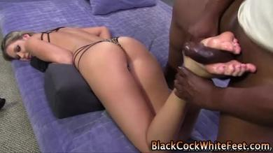 Blonde babe is jerking her black friend's cock