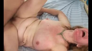 Horny granny shouts as she gets penetrated by a young stud.