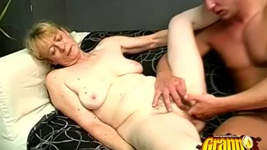 Slutty granny sucks cock and gets her hairy mature pussy finger-fucked