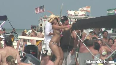<p>Beach party with many girls titties nicely and firm</p>