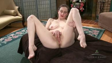 <p>Brunette Trixie enjoys teasing her hairy twat in solo</p>