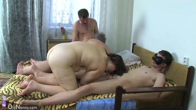 Chubby granny engages in groupsex