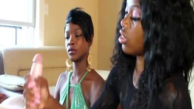 Black beauties gives a lucky dick a lusty hand job.
