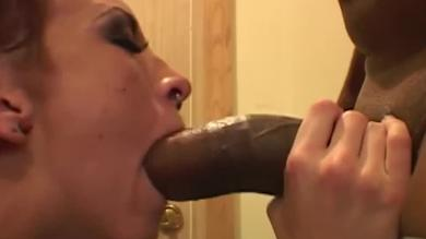 Horny amateur brunette slut sucking and licking a huge black cock at home